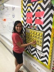 Dorinda Jones, third-grade reading, English and language arts teacher at Bradford Elementary, finishes up her calendar bulletin board.