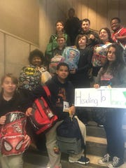 Members of the Titan Gifted Program of St. Bernard-Elmwood Place High School collect backpacks for students impacted by hurricane Harvey.