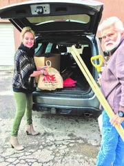 Jamie Estes and Casteel Martell unloading donations