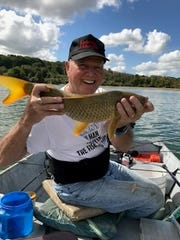 Ron Bern holds an 8-lb carp he caught at Spruce Run Reservoir on Sept. 27. It was released.