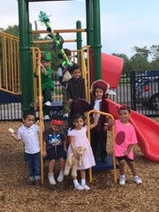 Pre-K4 students on the playground in their costumes