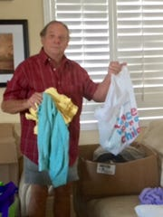 Treasure Coast Chapter of the Military Officers Association of America Program Director Dayne Clemmer prepares personal hygiene bags for homeless veterans.