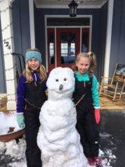 Nicki Groves sent this photo of some of her favorite snow people.