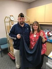 Members of VFW Post 5951 and Military Order of the Cootie Pup Tent 6 recently delivered more than 140 blankets to elderly veterans.