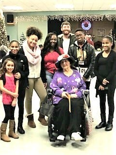 Members of the Boys & Girls Club of Vineland performed for hospitalized veterans at the New Jersey Veterans Memorial Home in Vineland recently to celebrate the holidays. Dotty Cullen and Friends sponsored the event, which included a variety of entertainment, singing, dancing, food and gift exchange. Dotty Cullen (front) is surrounded by members, staff and volunteers from the Boys & Girls Club of Vineland.