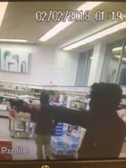 Authorities are searching for two men they say robbed