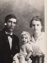 William Early (W.E.) and Maggie Priest, with their first child of seven, daughter Phyllis