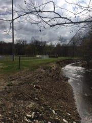 A creek runs near Floyd Central High School's softball