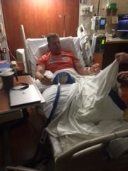 Tim Hopkins in a bed at West Chester Hospital after
