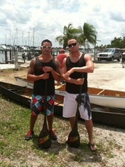 Josh Marzucco (left) and Jim DePalo pose near their canoe before the Great Dock Canoe Race in this updated photo.