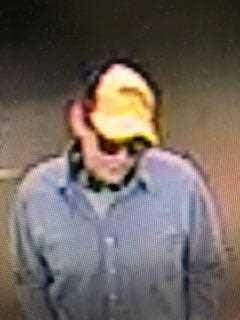This surveillance image shows a suspect in four robberies.