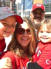 Mike Kessler and his family - wife, Susie, son, Danny and daughter, Lucy - enjoy a Reds game.