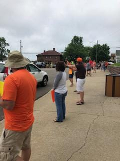 Students and parents paraded by the Intermediate School, Middle School and the High School at Claymont to bid farewell to the staff on Friday.