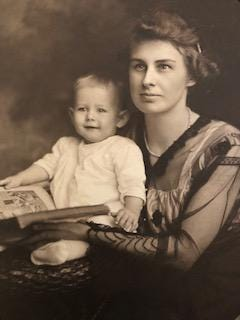 Edith O'Hara Batdorff, former Akron society columnist, sits with her son Emerson about 1919.
