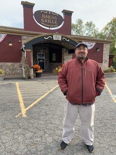 Bar 88 & Grille co-owner John-Paul Thomas stands in front of his restaurant at 88 Wales St. in Taunton.