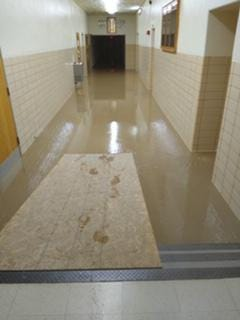 Standing water in the hallway of the industrial wing of East Peoria Community High School has canceled the return to in-school learning and forced the return of remote learning to start the school year.