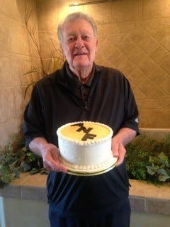 Former University of Iowa football coach Hayden Fry poses with an ANF cake Thursday in Mesquite, Nev. Saturday is Fry's birthday, and plans are already under way for September's seventh annual FRY fest in Coralville, where the 30th anniversary of ANF will be celebrated.