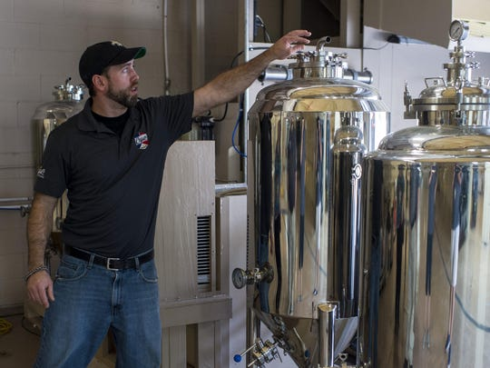 James Lutgring, operations manager and head brewer at Cajun Brewing in Lafayette, La., explains the various operations of the fermentation vessels used to create beers at the new facility, Tuesday, August 25, 2015.