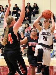 Tularosa's Shacie Marr, right, tries to score in the