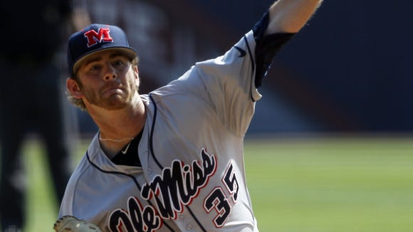 Mississippi's Jeremy Massie (35) pitches against Vanderbilt during the first inning at the Southeastern Conference NCAA college baseball tournament on Thursday, May 22, 2014, in Hoover, Ala. (AP Photo/Butch Dill)