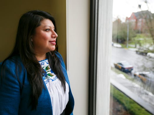 Rep. Teresa Alonso Leon looks out the window of her