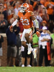 Clemson defensive back Van Smith (23) leaps during the 3rd quarter against Louisville on Oct. 1 at Clemson's Memorial Stadium.