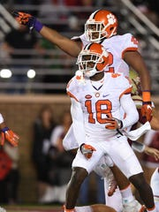 Clemson defensive back Jadar Johnson (18) and defensive lineman Christian Wilkins (42) react during the 2nd quarter at Boston College's Alumni Stadium in Chestnut Hill, MA on Friday, October 7, 2016.