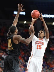 Clemson forward Donte Grantham (15) shoots over Oakland forward Isaiah Brock (10) in the first round of the National Invitation Tournament on Tuesday, March 14,  2017 at Clemson's Littlejohn Coliseum.