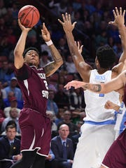 Texas Southern guard Zach Lofton (2) shoots over UNC forward Isaiah Hicks (4) during the 1st round of the NCAA Tournament at Bon Secours Wellness Arena in downtown Greenville on Friday, March 17, 2017.