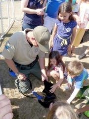 Kitsap County Sheriffs K-9 deputy Aaron baker and new puppy Blue at the Kitsap County Fair and Stampede. The fair featured a K-9 demonstration.