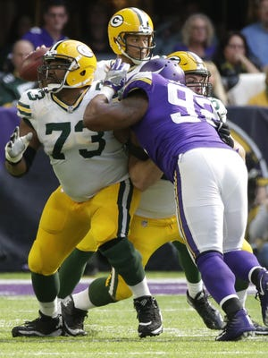 Green Bay Packers offensive guard Jahri Evans (73) and center Corey Linsley (63) provide pass protection for quarterback Brett Hundley (7) during the third quarter of their game against the Minnesota Vikings Sunday, October 5, 2017 at U.S. Bank Stadium in Minneapolis.