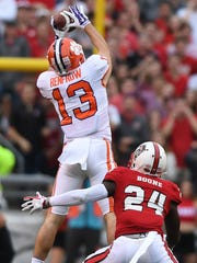 Clemson wide receiver Hunter Renfrow (13)  catches a pass over NC State safety Shawn Boone (24) during the 1st quarter on Saturday, Nov. 28, 2017 at Clemson's Memorial Stadium.