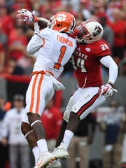 NC State safety Shawn Boone (24) breaks up a pass intended for Clemson wide receiver Trevion Thompson (1) during the 1st quarter on Saturday, Nov. 28, 2017 at Clemson's Memorial Stadium.
