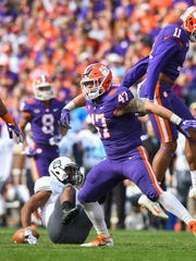 Clemson linebacker James Skalski (47) celebrates after