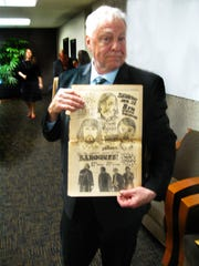 Artist Dean Nimmer, 72, holds up a poster for a 1967