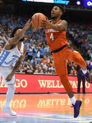 Clemson guard Shelton Mitchell (4) drives to the basket past North Carolina guard Joel Berry II (2) during the 1st half on Tuesday, January 14, 2018 at UNC's Smith Center in Chapel Hill, N.C.
