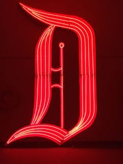 "The neon ""D"" glowed atop the Disneyland Hotel from"