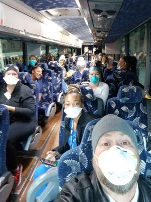 Bus driver Richard Holmgren, of Salina, takes a selfie before driving a bus of nurses from thee Park Central Hotel in New York to a hospital to help during the height of the COVID-19 crisis.