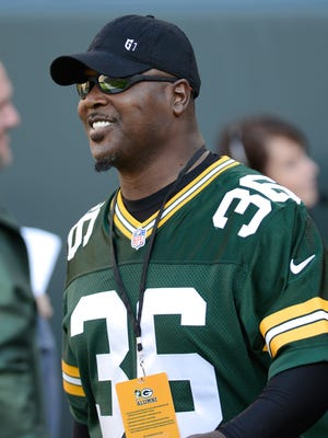 Leroy Butler walks out of the tunnel as he is introduced at halftime of the Packers' Week 2 game against the Jets in 2014.