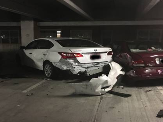 A couple of the 16 total vehicles damaged in a parking