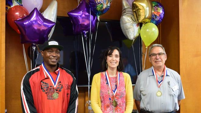 Craven Community College recently presented three employees with annual Excellence Awards in the categories of Staff, Faculty and Adjunct Faculty. Pictured left to right: Donell Bryant, Barbering program manager and instructor; Carmela Magliocchi-Byrnes, chemistry instructor; and Joe Randazzo, Electrical trades instructor.