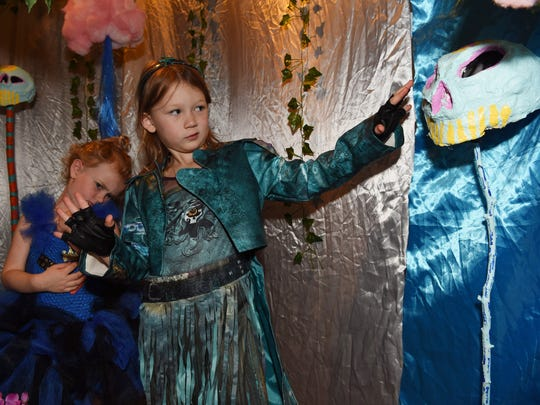 Gilvey, 5, right, and Fenner, 3, left, Barnett-Zunino go through the Halloween-themed exhibits at The Wassaic Project in Wassaic.
