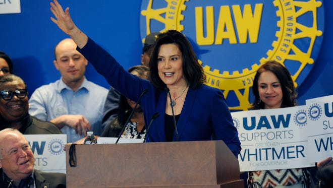 Gretchen Whitmer, Democratic candidate for governor, raises her hand during remarks after accepting the endorsement from the UAW Monday, March 19, 2018, in Detroit. (Clarence Tabb Jr./Detroit News via AP)