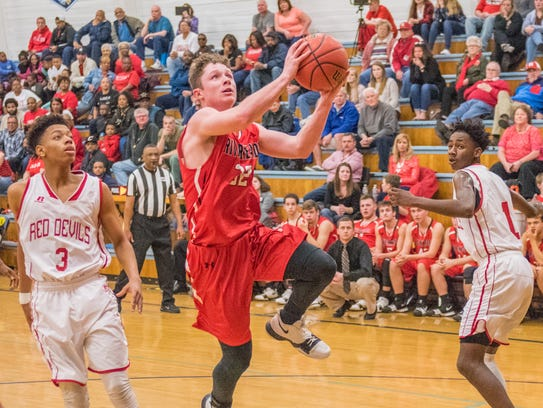 Riverheads' Braeson Fulton drives in for a layup against