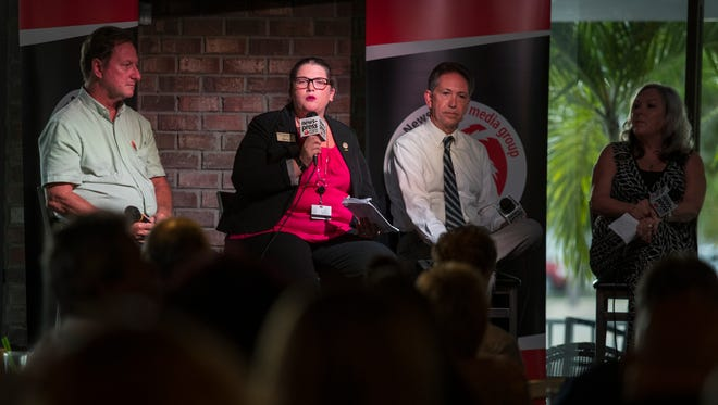 From left, Brian Bishop, Amy Yearsley, John Szerlag and Suzanne Vasbinder were the panelists during a town hall meeting focusing on affordable housing sponsored by The News-Press and held at Big Blue Brewing in Cape Coral Wednesday evening.