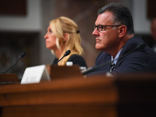 Former USA Gymnastics CEO Steve Penny, right, is excused