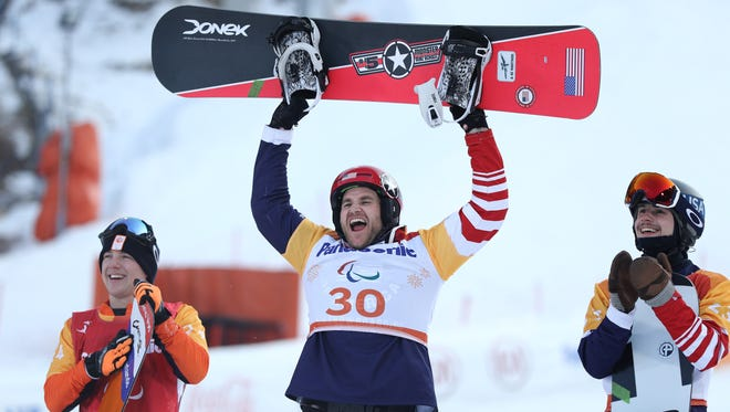 PYEONGCHANG-GUN, SOUTH KOREA - MARCH 12:  Mike Schultz of USA (30) celebrates after winning the Gold medal with Silver medallist Chris Vos of Netherlands (L) and Bronze medallist Noah Elliott of USA in the Men's Snowboard Cross SB-LL1 during day three of the PyeongChang 2018 Paralympic Games on March 12, 2018 in Pyeongchang-gun, South Korea.  (Photo by Maddie Meyer/Getty Images,)