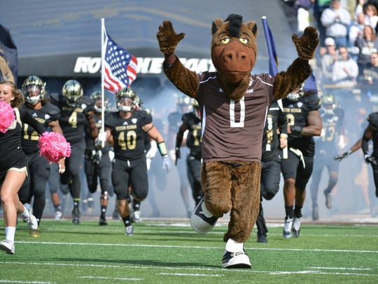 Buster Bronco leads the team out of the tunnel at Waldo