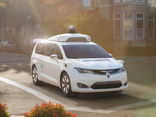 Waymo, the self-driving car project birthed by Google, was shown on the autonomous Chrysler Pacifica minivan as shown at the North American International Auto Show in 2017.