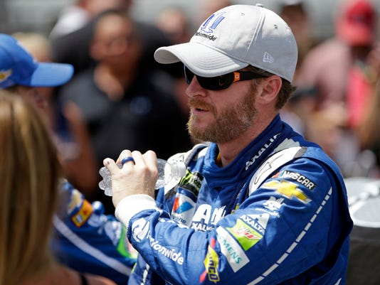 Dale Earnhardt Jr. (88) prepares before the NASCAR Brickyard 400 auto race at Indianapolis Motor Speedway in Indianapolis, Sunday, July 23, 2017. (AP Photo/AJ Mast)